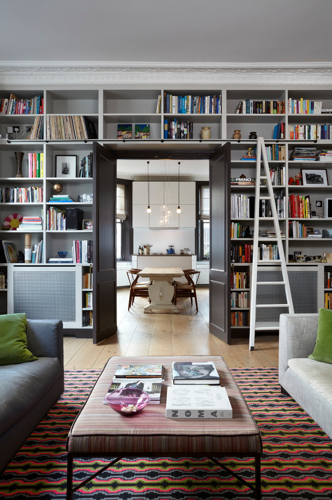 Living room library - transitional living room library idea in London