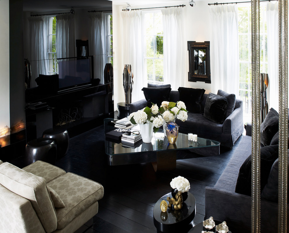 Example of a large trendy black floor living room design in London with a wall-mounted tv