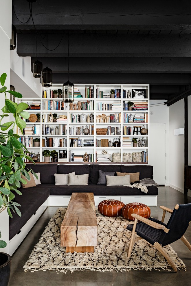 Example of an urban concrete floor living room library design in Portland