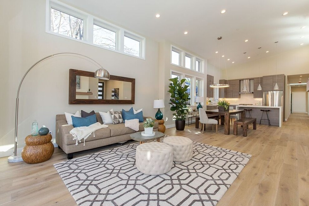 Example of a mid-sized transitional open concept and formal light wood floor and beige floor living room design in San Francisco with beige walls, a ribbon fireplace, a metal fireplace and no tv