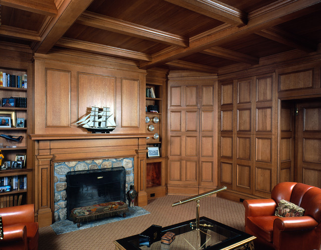 Oak library with stone fireplace traditional living room