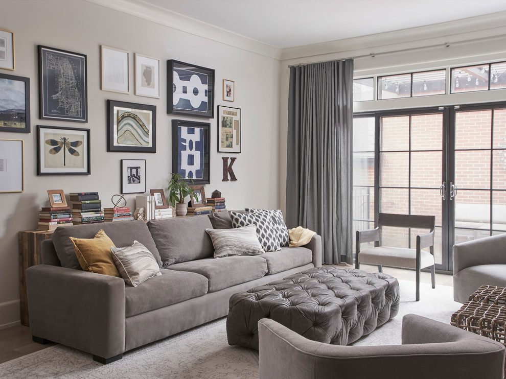 Example of a transitional formal light wood floor and beige floor living room design in Chicago with beige walls