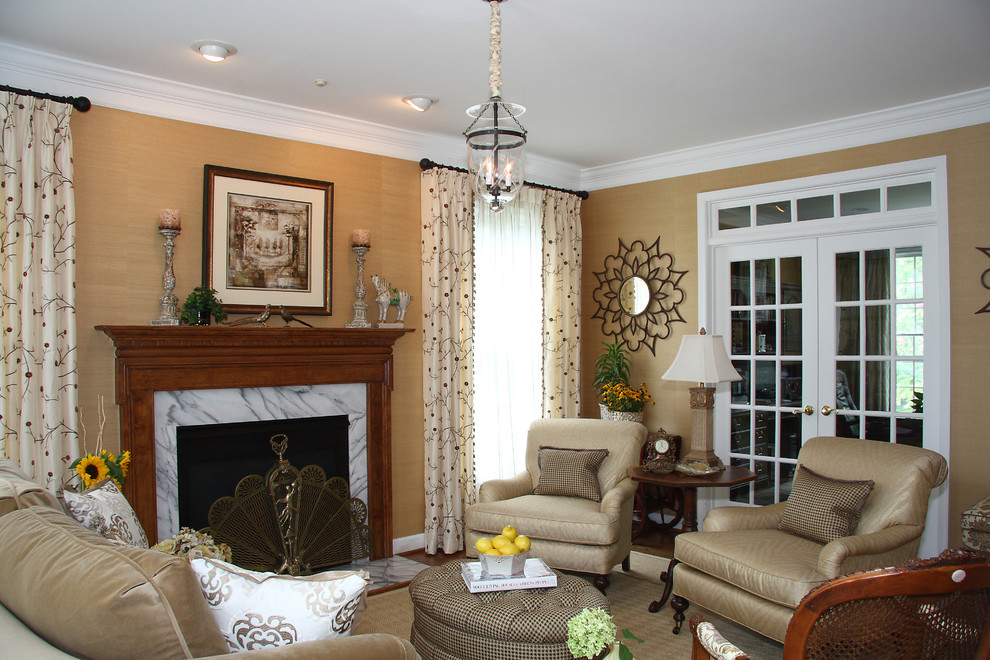 Elegant enclosed living room photo in DC Metro with beige walls, a standard fireplace and no tv
