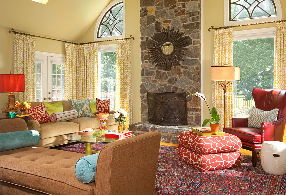 Inspiration for an eclectic living room remodel in DC Metro with yellow walls, a standard fireplace and a stone fireplace