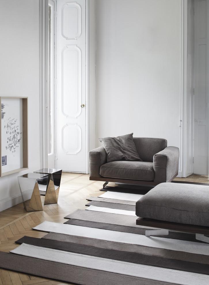 Living room - eclectic medium tone wood floor living room idea in Philadelphia with white walls