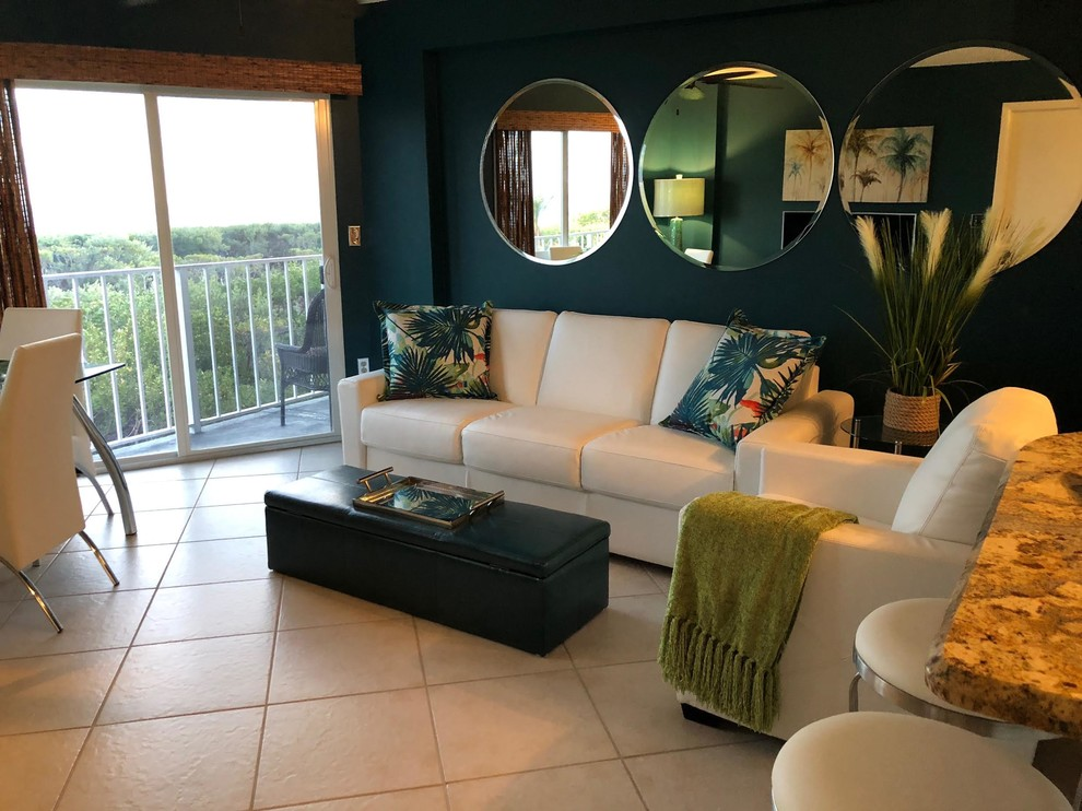 Example of a mid-sized beach style open concept ceramic tile and beige floor living room design in Boston with blue walls, no fireplace and a tv stand