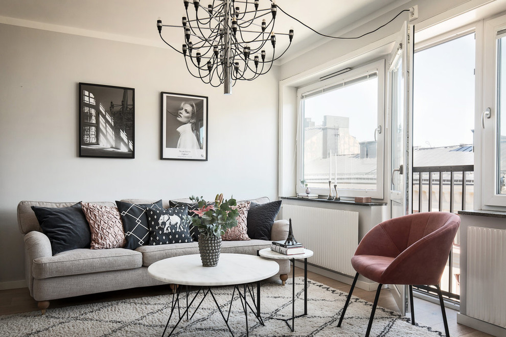 Inspiration for a small scandinavian living room remodel in Stockholm with gray walls