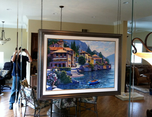 Oil Painting On Chain Over Mirror Wall Traditional Living Room