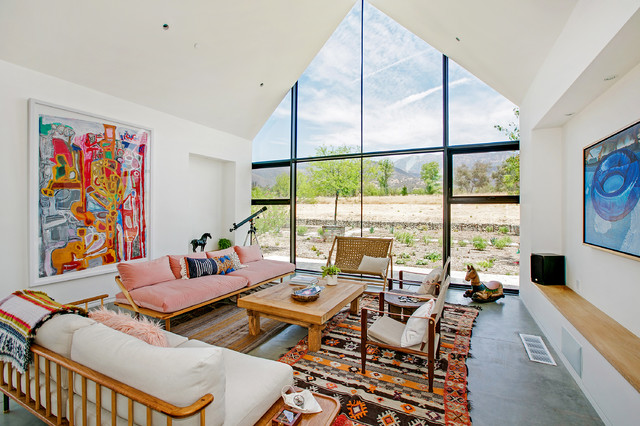 Example of a cottage concrete floor and gray floor living room design in Los Angeles with white walls