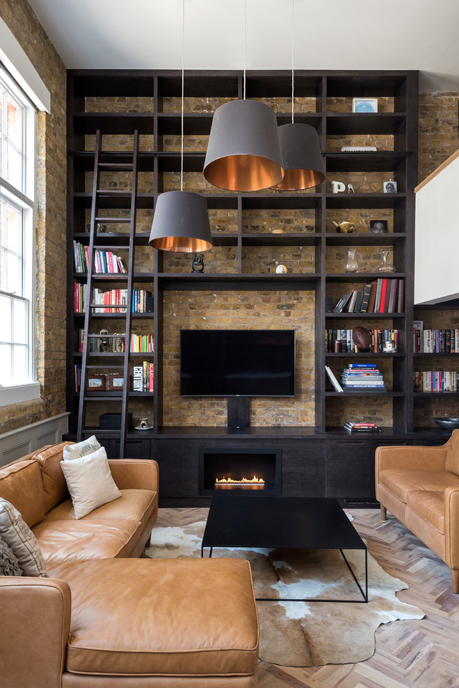 Inspiration for a mid-sized industrial open concept light wood floor and brown floor living room remodel in London with beige walls, a ribbon fireplace, a wood fireplace surround and a wall-mounted tv
