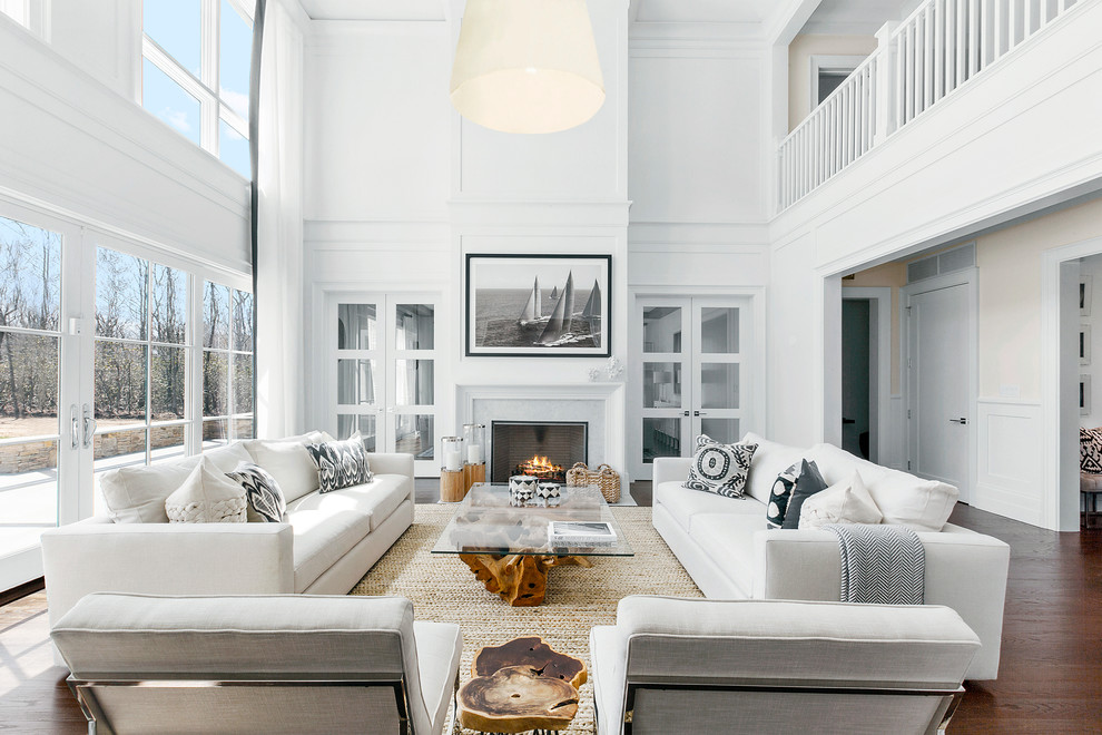 Inspiration for a large coastal formal and open concept dark wood floor and brown floor living room remodel in New York with white walls, a standard fireplace, a tile fireplace and no tv