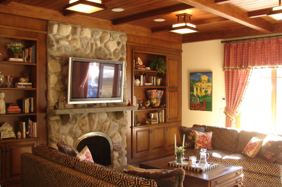 Living room - rustic living room idea in New York with a stone fireplace