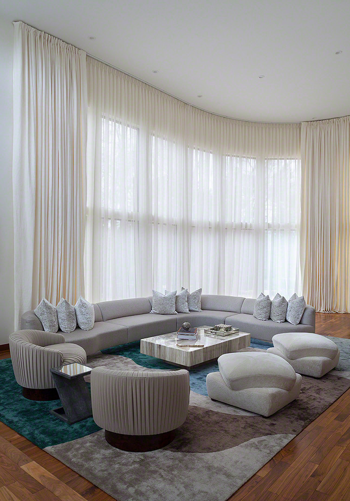 Huge trendy living room photo in New York with white walls and no tv