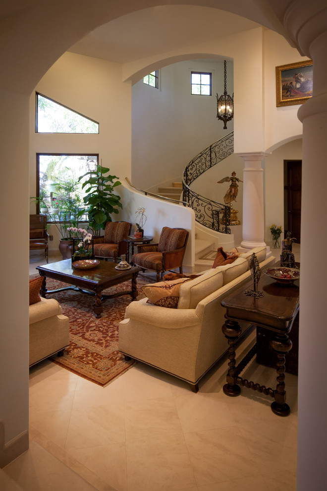 Living room - huge mediterranean formal and open concept living room idea in Los Angeles with white walls, a standard fireplace, a stone fireplace and no tv
