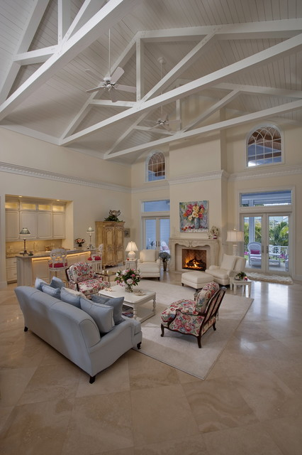 Inspiration for a tropical marble floor living room remodel in Miami with a bar, white walls and a standard fireplace