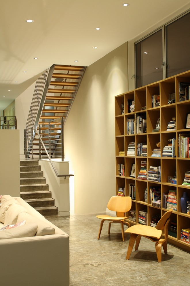 Inspiration for a contemporary living room library remodel in Los Angeles with beige walls