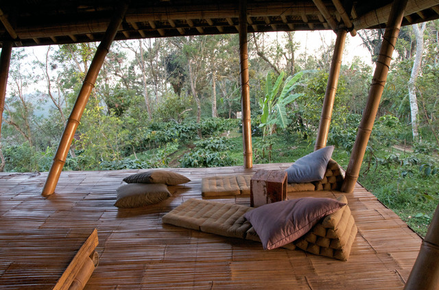 Open air living in the mountains of Bali tropical-living-room