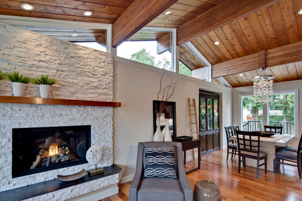 Example of a mid-sized transitional open concept medium tone wood floor living room design in Vancouver with beige walls, a stone fireplace, no tv and a ribbon fireplace