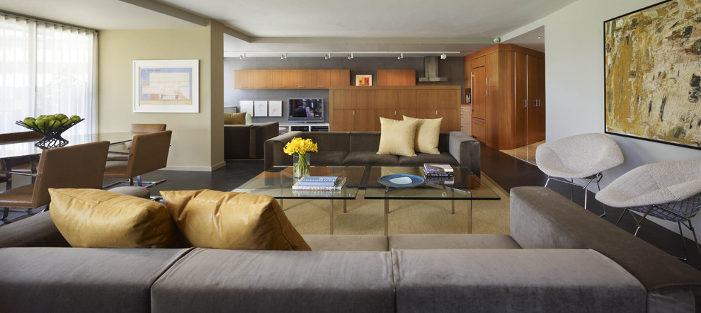 Example of a trendy open concept living room design in DC Metro with beige walls