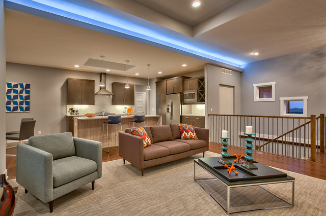 Inspiration For A Contemporary Loft Style Medium Tone Wood Floor Living Room  Remodel In Omaha