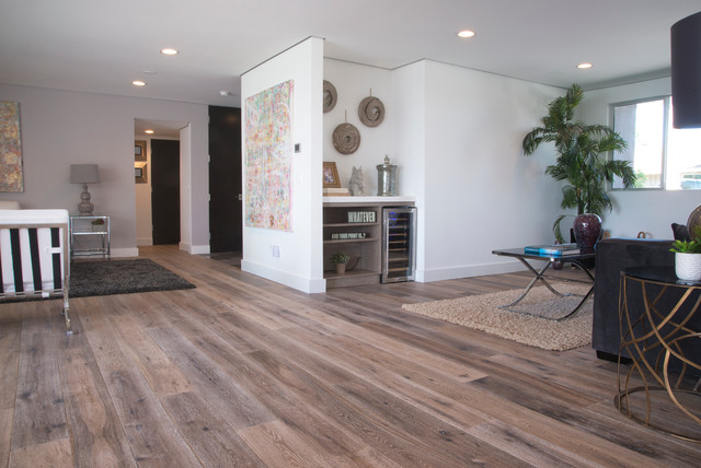 Open Floor Plan With Deep Smoked Oak Flooring In Woodland Hills Contemporary Living Room