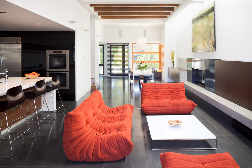 Example of a trendy open concept living room design in Vancouver with white walls