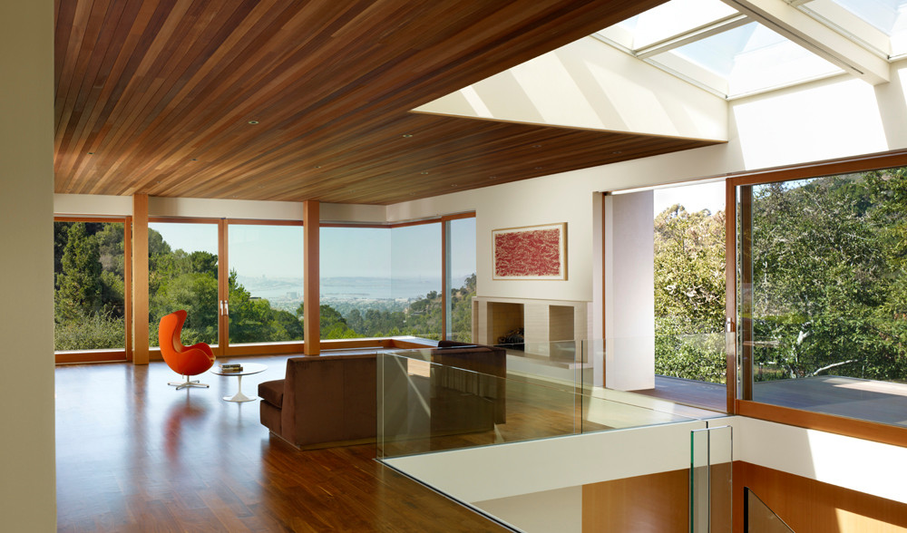 Open living space with hardwood floors and lots of natural light