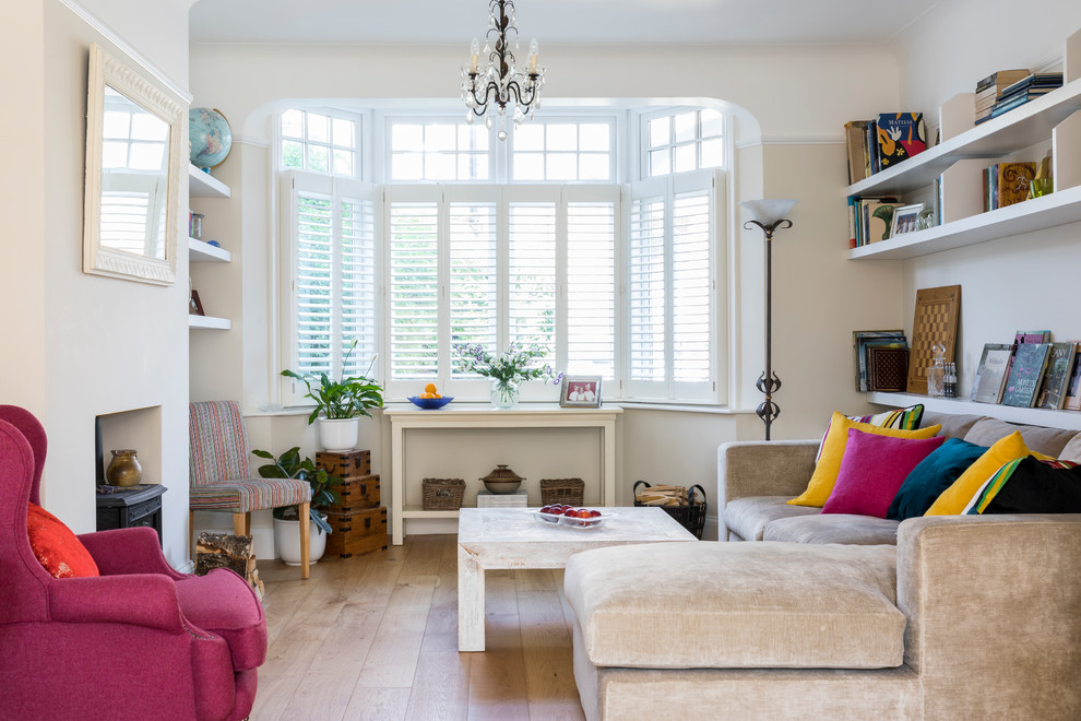 Living room - small eclectic enclosed light wood floor and beige floor living room idea in London with a wood stove