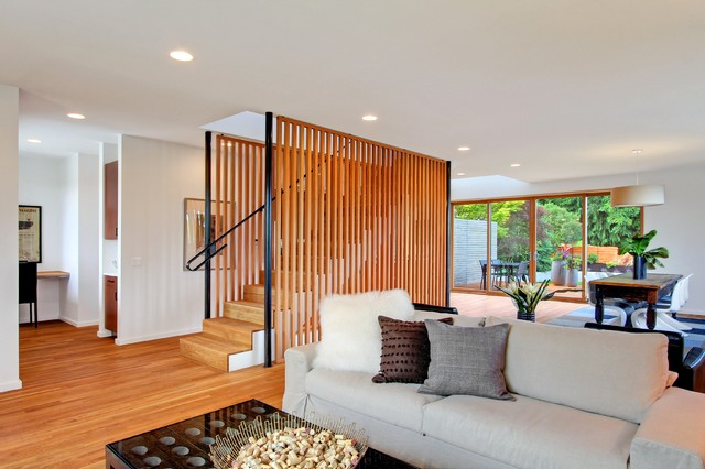 Example of a trendy living room design in Seattle with white walls