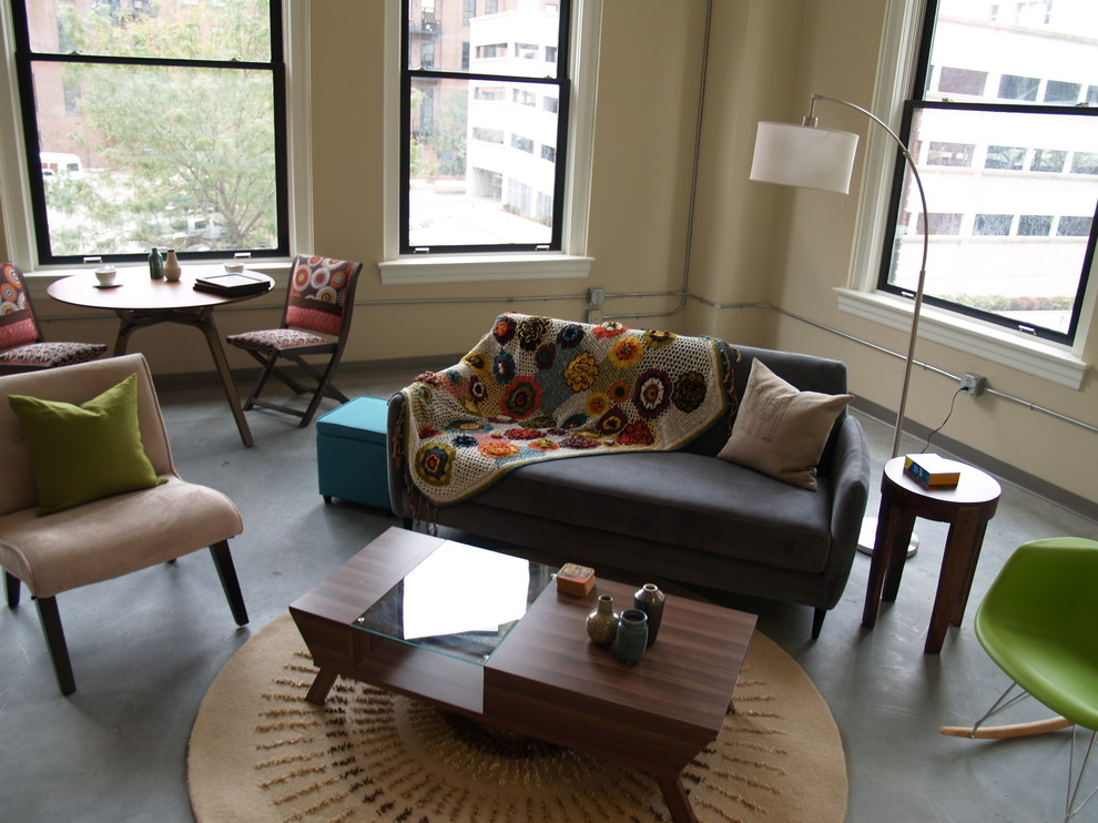 Inspiration for an eclectic concrete floor living room remodel in St Louis with beige walls