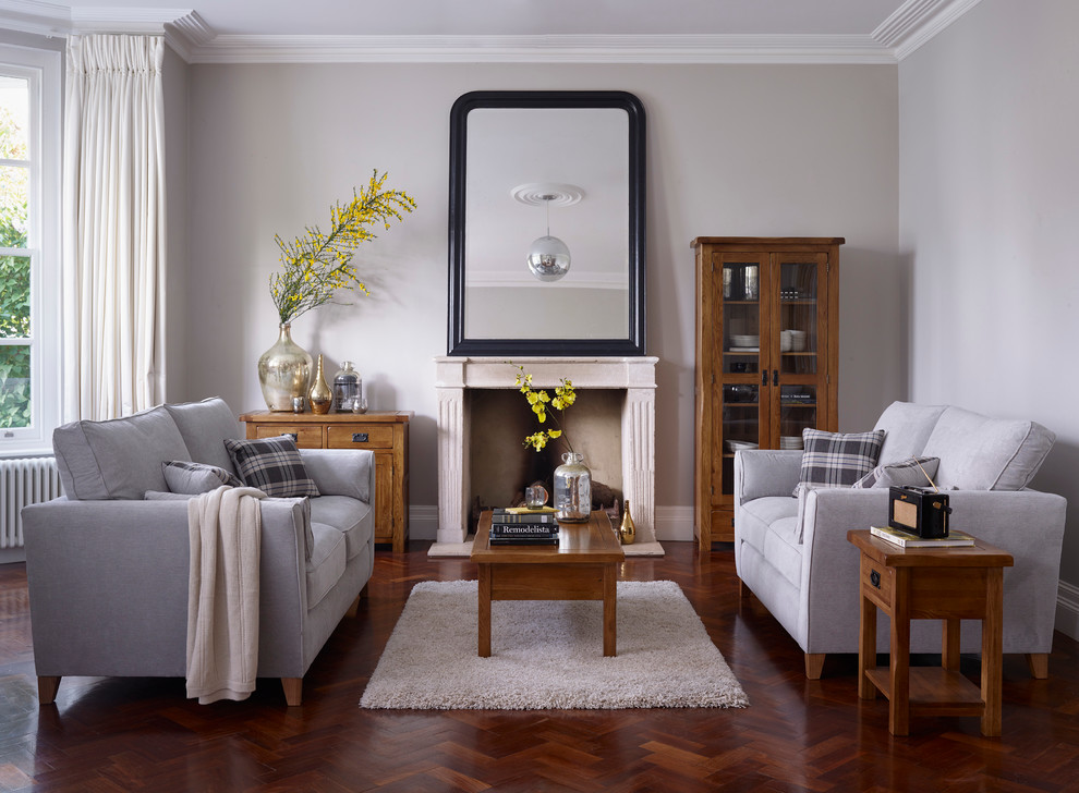 Example of a classic formal dark wood floor living room design in Wiltshire with gray walls, a standard fireplace and no tv