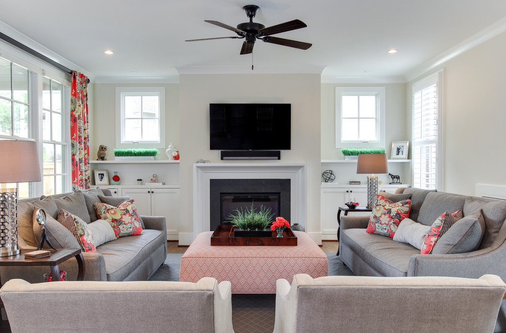 Living room - transitional living room idea in Raleigh with a standard fireplace