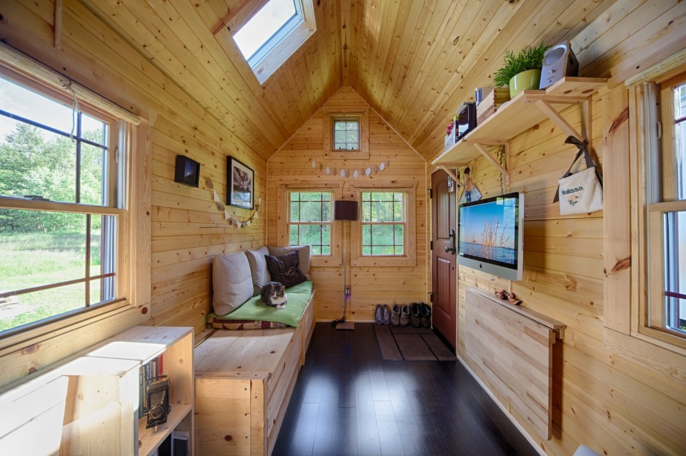 Example of a small mountain style living room design in Seattle with a wall-mounted tv