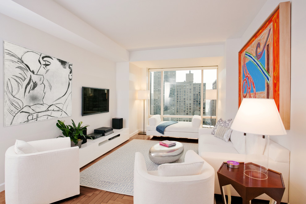 Living room - small contemporary enclosed medium tone wood floor living room idea in New York with white walls and a wall-mounted tv