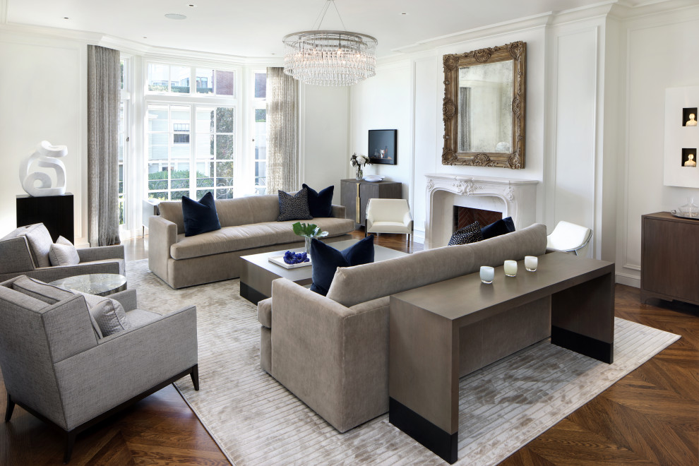 Inspiration for a large transitional formal and enclosed medium tone wood floor living room remodel in San Francisco with a standard fireplace and a plaster fireplace