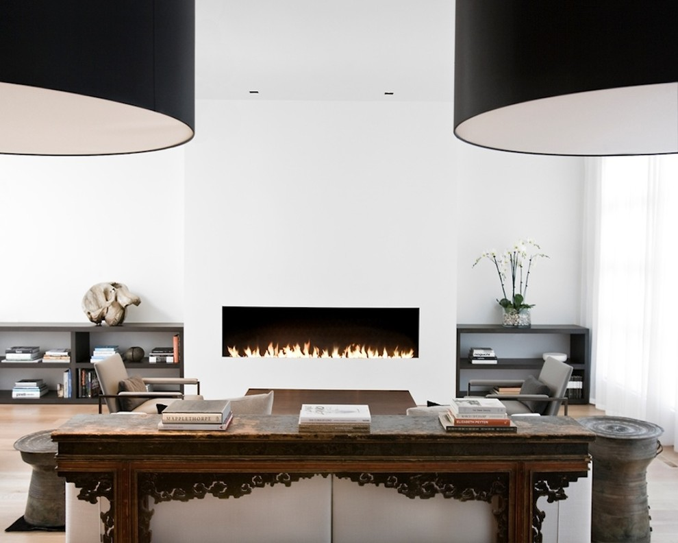 Living room - contemporary living room idea in San Francisco with white walls and a ribbon fireplace