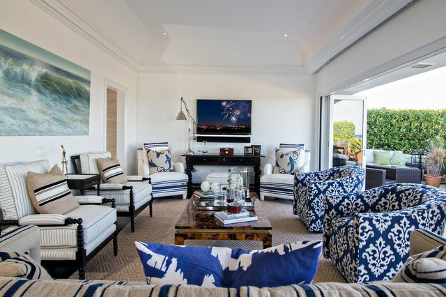 Inspiration for a beach style formal living room remodel in Boston with white walls and a wall-mounted tv