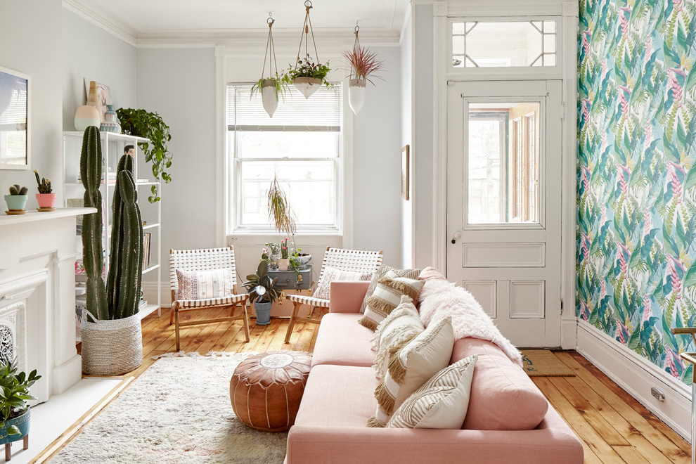 Living room - eclectic light wood floor living room idea in New York with a standard fireplace, no tv and multicolored walls