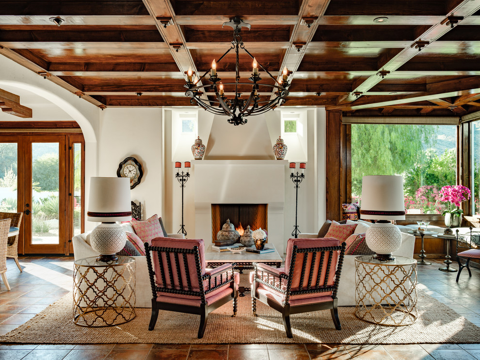 Living room - mediterranean brown floor living room idea in Los Angeles with white walls and a standard fireplace
