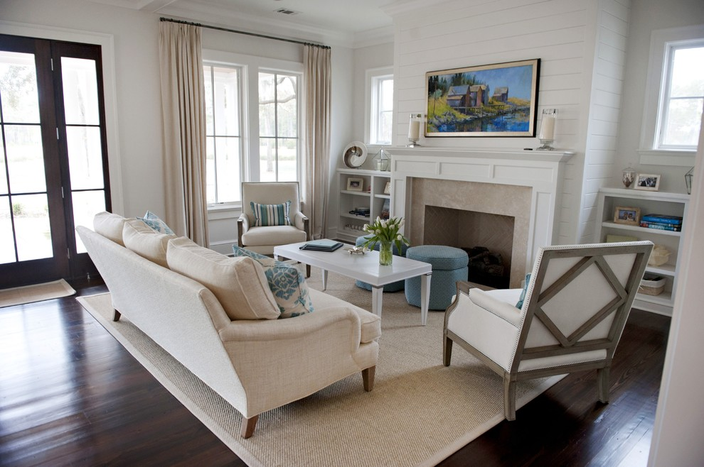 Beach style dark wood floor living room photo in Atlanta with white walls, a standard fireplace and a stone fireplace