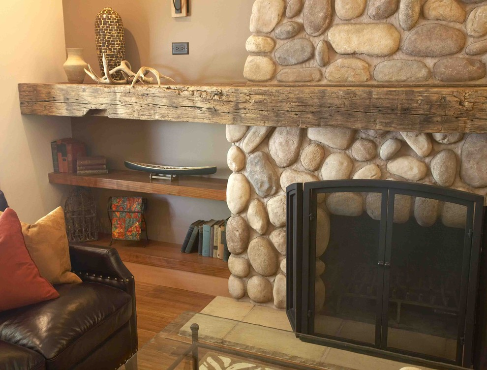 Mid-sized mountain style open concept bamboo floor and brown floor living room photo in San Francisco with brown walls, a standard fireplace and a stone fireplace
