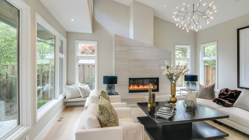 Large trendy formal and enclosed light wood floor and beige floor living room photo in San Francisco with beige walls, a tile fireplace, a ribbon fireplace and no tv