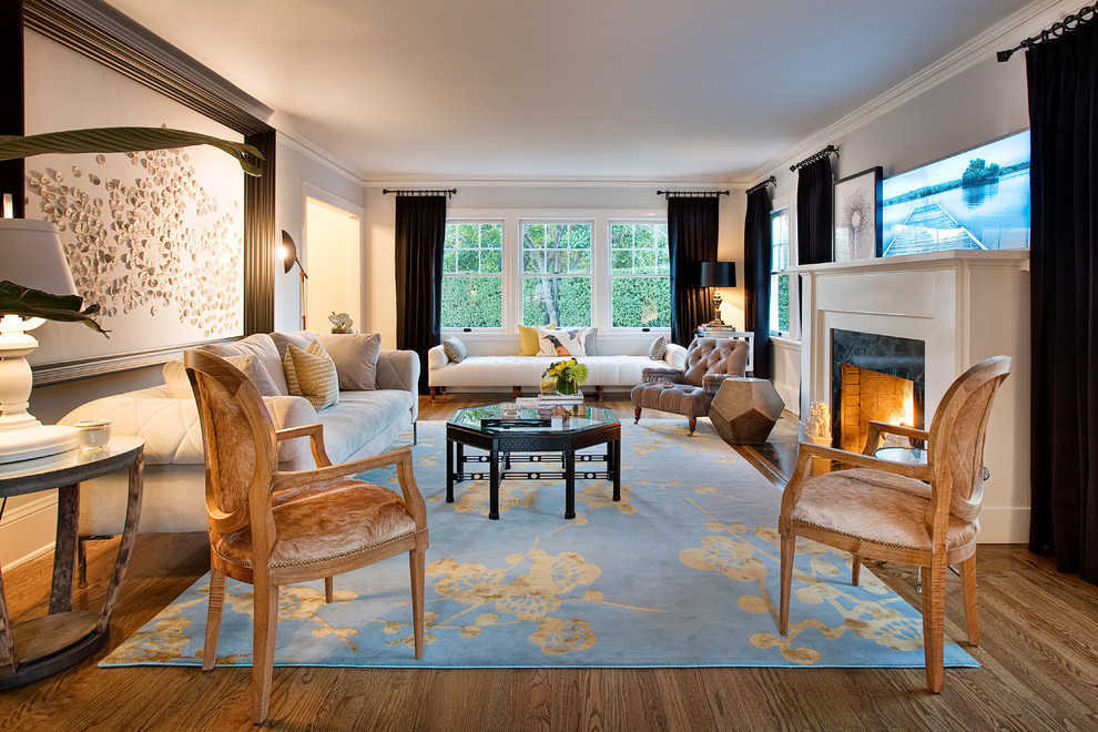Inspiration for an eclectic living room remodel in San Francisco with white walls and a standard fireplace