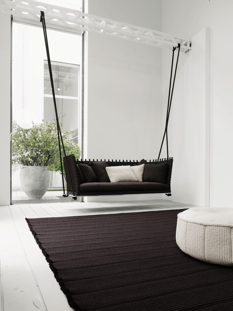 Living room - contemporary living room idea in Other with white walls