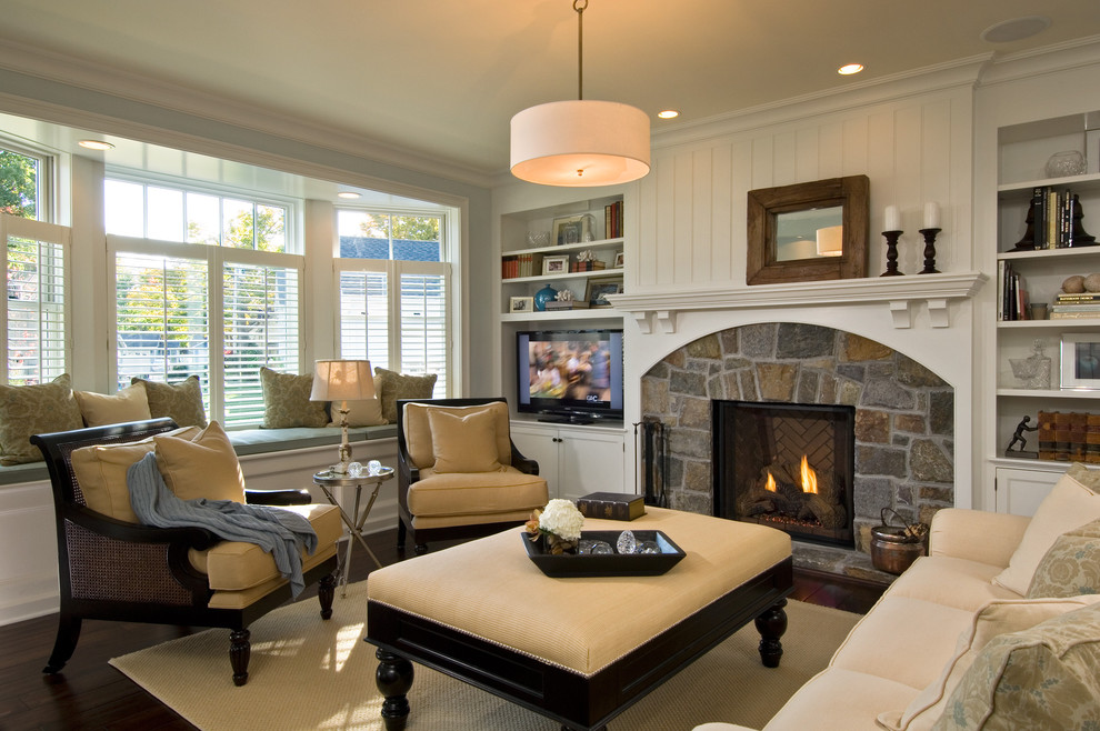 Elegant living room photo in New York with a stone fireplace