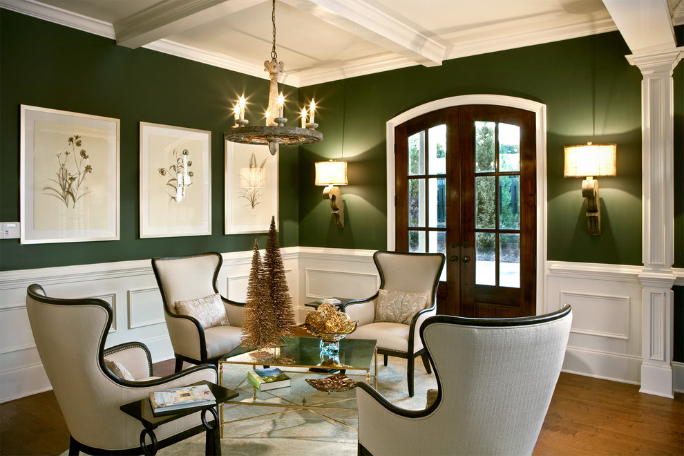 Example of a classic formal and open concept medium tone wood floor living room design in Charlotte with green walls