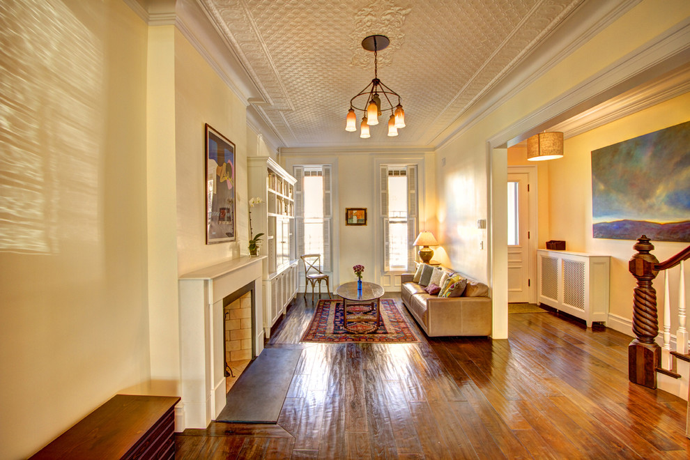 Elegant living room photo in New York with yellow walls