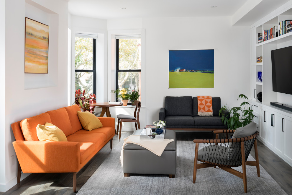 Inspiration for a contemporary living room remodel in New York with a media wall