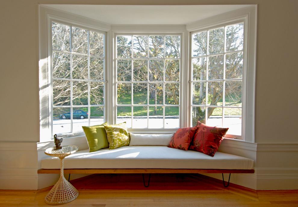 Living room - 1950s medium tone wood floor living room idea in San Francisco with white walls