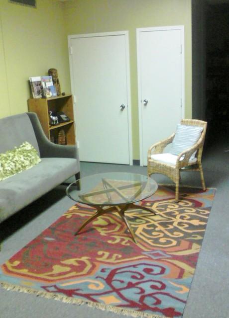 Partners for Development Office re-design. contemporary-living-room